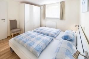 Zweites Schlafzimmer mit Doppelbetten